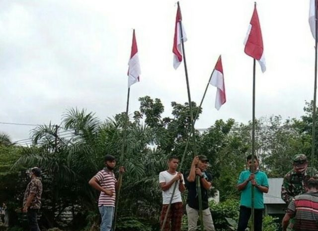 Sambut HUTRI, Dharmasraya Kibarkan 1000 Bendera Merah Putih